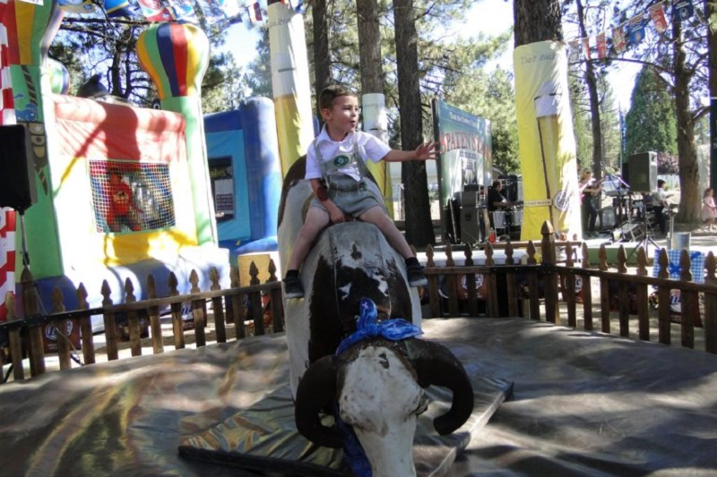 The Kids' play area at Big Bear Lake Oktoberfest has been enhanced with new activities for kids to enjoy throughout the festive time. What to do at Big Bear Lake | Big Bear Lake October Events | Things to do at Big Bear Lake #travel #oktoberfest #bigbearlake
